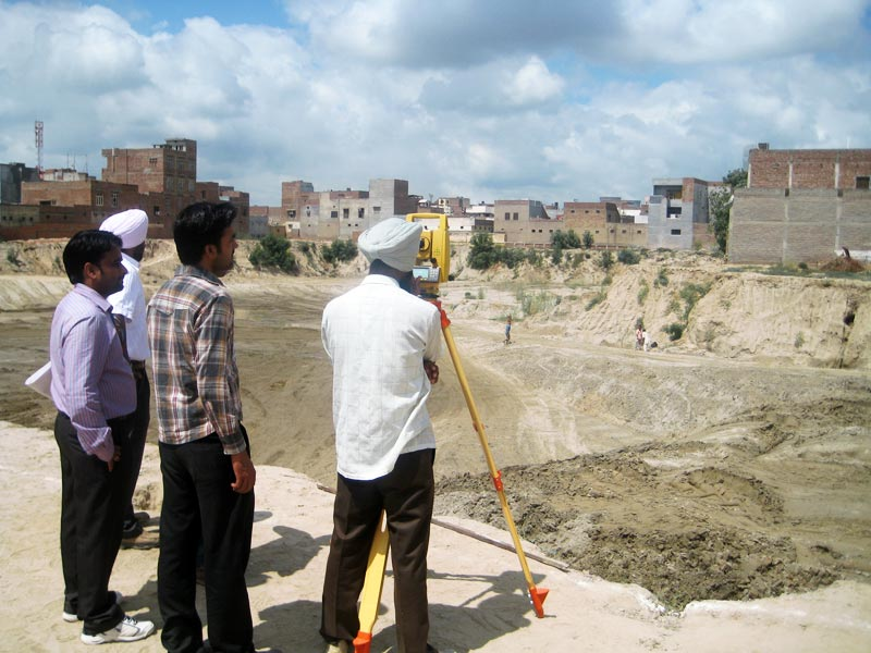How do you survey land?