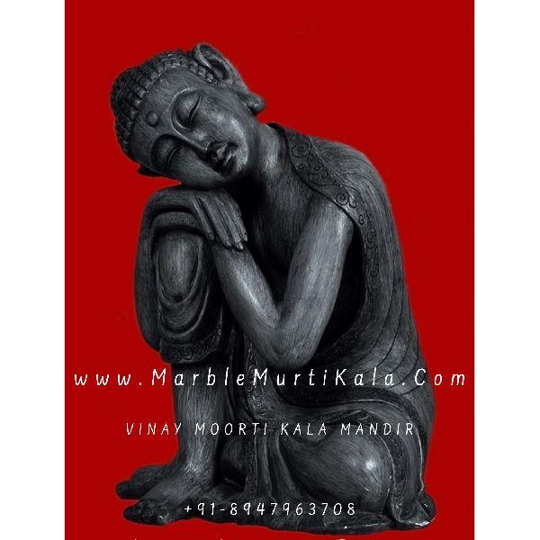 Black Stone Buddha in Sitting Position
