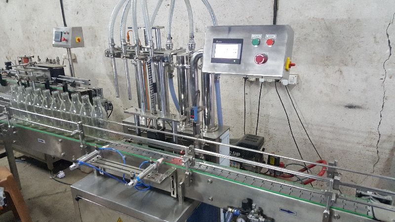 PLC Servo Based Automatic Liquid Filling Machine