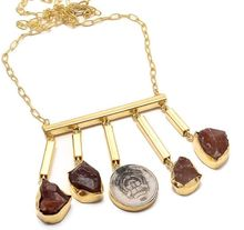 22 carat gold polish red onyx with metal coin clam necklace
