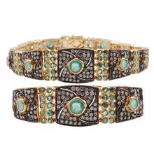 Mixed metal jewelry with emeralds diamonds studded victorian bracelet