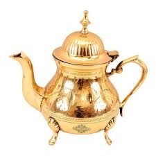 serving brass tea pot