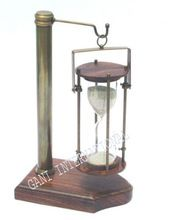 Nautical brass hanging sand timer with wooden base