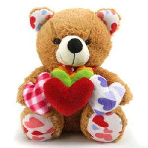 Brown Soft Teddy Bear Holding Hearts In Hand