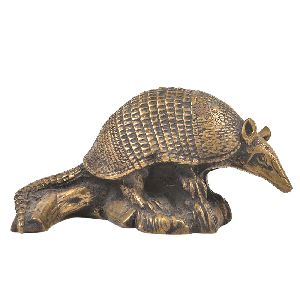 Bronze Armadillo Sitting on a Log