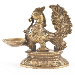 Elegant Brass Diya With Peacock Figurine