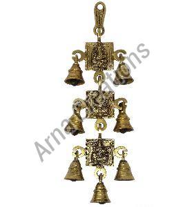 Brass Ganesh Laxmi and Saraswati Images with 7 Bells Wall Hanging
