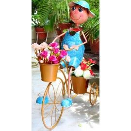 Boy on cycle with two pots planter for home, garden & balcony decor