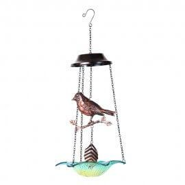 Hanging metal bird with glass base chime