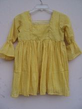 yellow color polka dot printed beautiful kids party wear dress