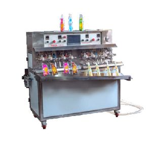 Fruit Juice Filling and Sealing Machine