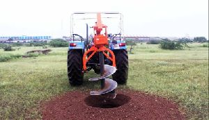 Auger for excavator on Tractor