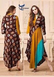 SERIMA LAUNCHED KUMB GLAMOUR HEAVY RAYON PRINT LONG GOWN STYLE KURTIS WHOLESALE DEALER SURAT