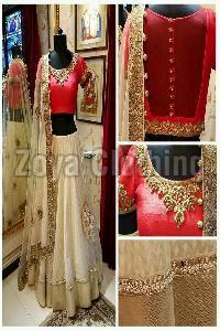 Off White & Red Net & Raw Silk Lehenga Choli