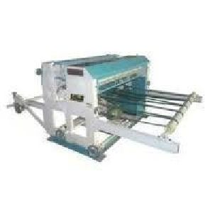 Programmatic Reel To Sheet Cutting Machine