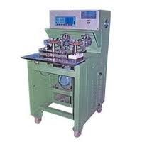 coil tapping machine