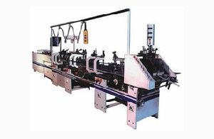 HIGH SPEED CARTON FOLDING AND GLUING MACHINE