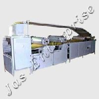Dough sheeter with rotery die cutting unit