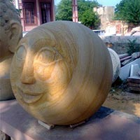 Face Carved on  Ball
